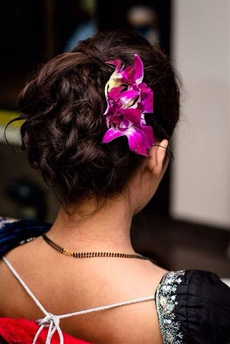 south indian bridal reception hairstyle hair bun  orchids indian bridal hairstyles