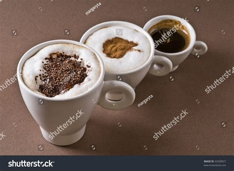 Moccachino Coffee Latte three coffee cups espresso cappuccino mochaccino stock photo 33358927