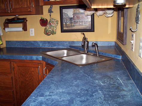 modern kitchen interior design with blue countertop materials tile with small washbasin and
