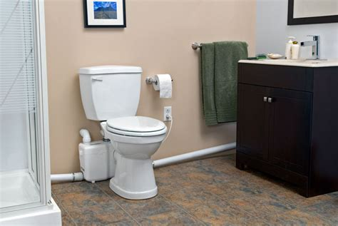 toilets with pumps for basements how do saniflo up flush toilets work abode
