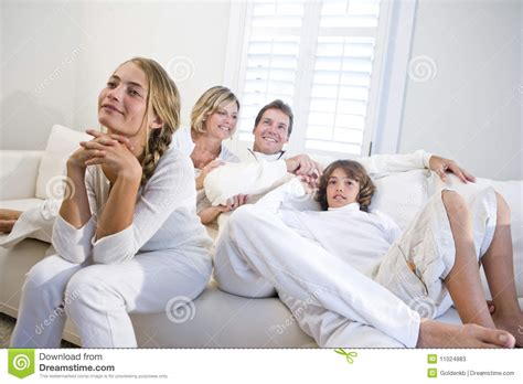 sofa for watching tv family sitting together on white sofa watching tv stock