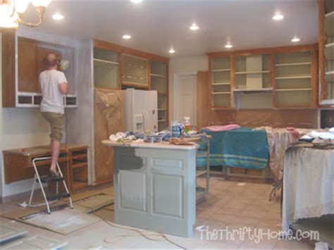 do you paint the inside of kitchen cabinets the thrifty home kitchen remodel painting cabinets