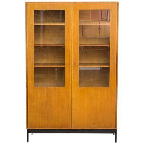 mid century science storage cabinet with black metal base