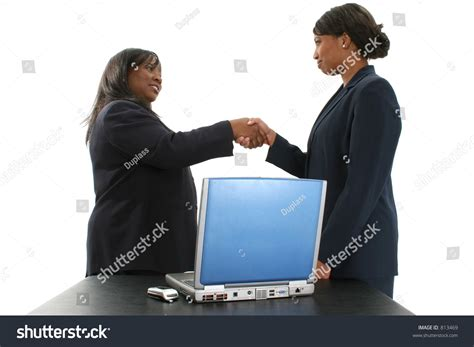 south american using laptop stock photos south american using laptop stock images alamy two beautiful african american business women shaking hands standing behind a table with laptop