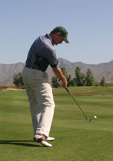 golfer swinging golf and podiatry ian griffiths sports podiatry