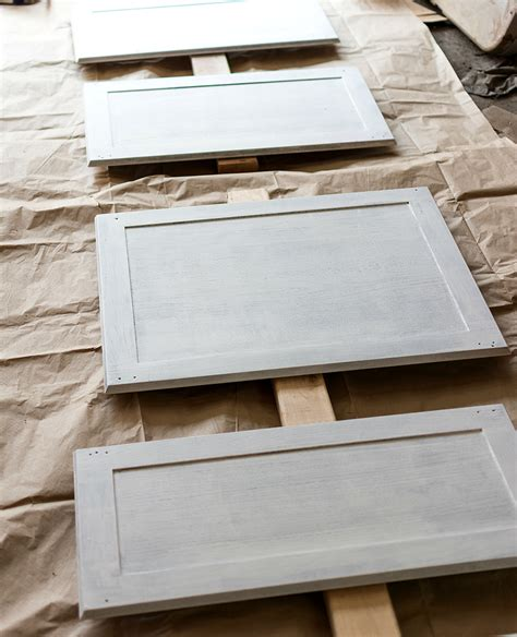 Paint Grade Kitchen Cabinets by How To Paint Builder Grade Cabinets