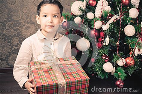 new year the big race merry happy boy holding gift box stock photo