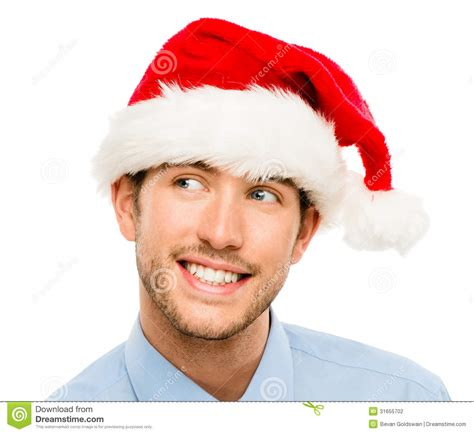 closeup of caucasian man wearing christmas hat for santa
