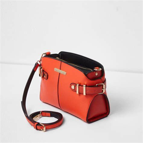 river island bright orange tab buckle side cross bag