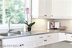 gray soapstone countertops hexagon subway tile backsplash maple cabinets painted