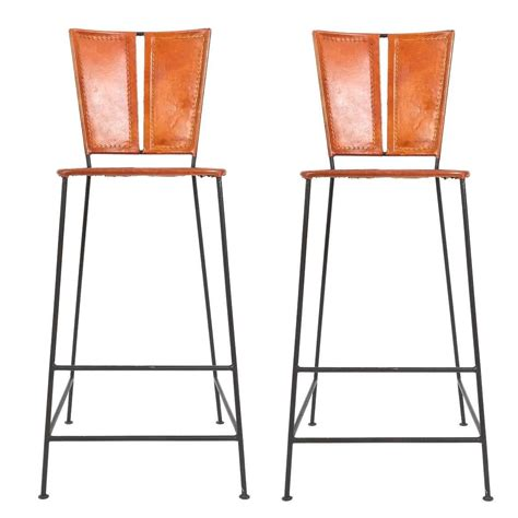 pair of custom made leather bar stools circa 1960