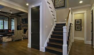 dark wood staircase with white wood railing traditional