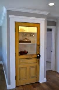 vintage farmhouse door repurposed as pantry door by