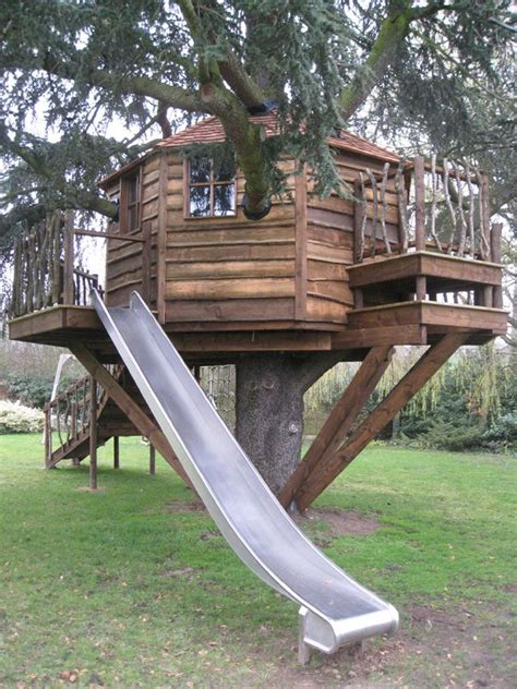 tree house slide treehouse with slide treehouses hobbit fairy houses pinterest