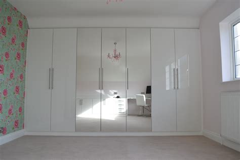 stylish bedroom  gloss white cabinet  custom