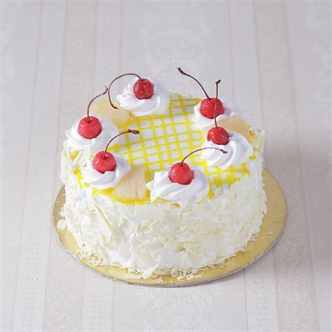 Eggless Pineapple Fresh Cream Cake   Giftacrossindia