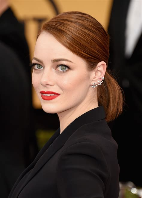 emma stone ear piercings ear cuffs at sag 2015 were by far the coolest accessory on
