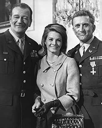 John Wayne and Angie Dickinson and Kirk Douglas in Cast a