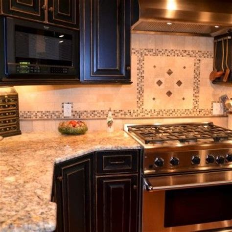 black glass tiles for kitchen backsplashes silver gold granite countertops with black cabinets