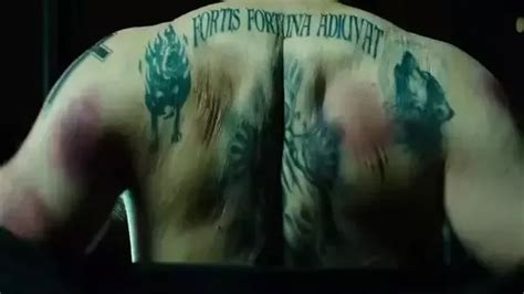 john wick back tattoo language what is the meaning of the tattoo on john wick s back quora