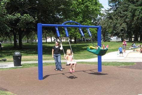 a child swings on a playground swing 10 great places to soar on a swing
