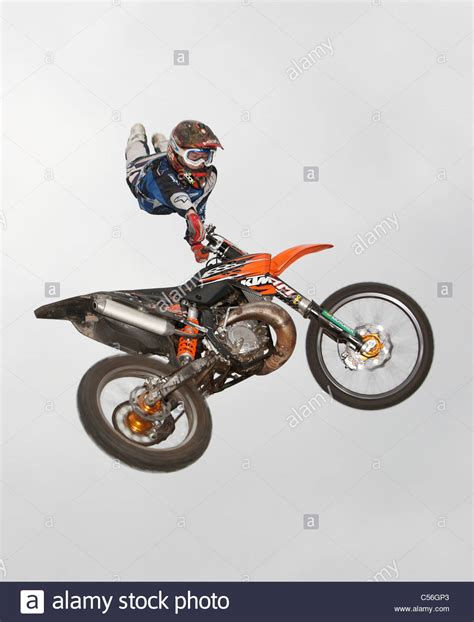 australian freestyle motocross riders freestyle moto fmx riders in mid air stock photo 37638891