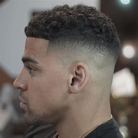 tapered sides with curls black men 50 fade and tapered haircuts for black men