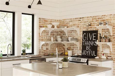 gray green cabinets cottage kitchen urban grace kitchen with exposed brick wall cottage kitchen