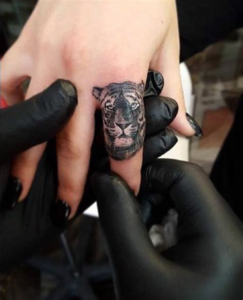 tiger finger tattoo 40 awesome finger tattoos for and finger