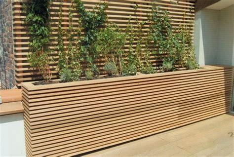 love this modern patio planter box under deck wall