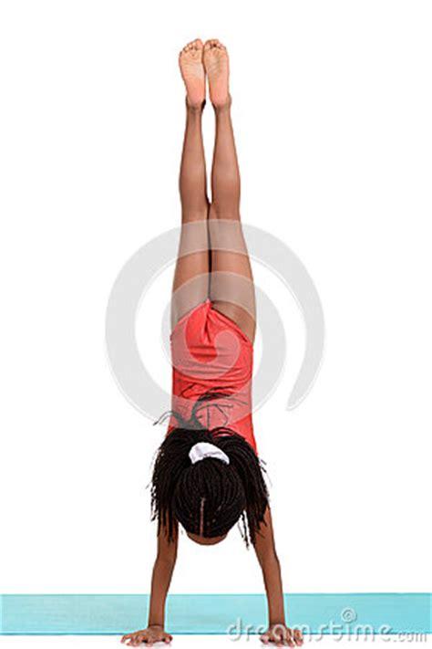 young girl  gymnastics handstand royalty  stock photo image