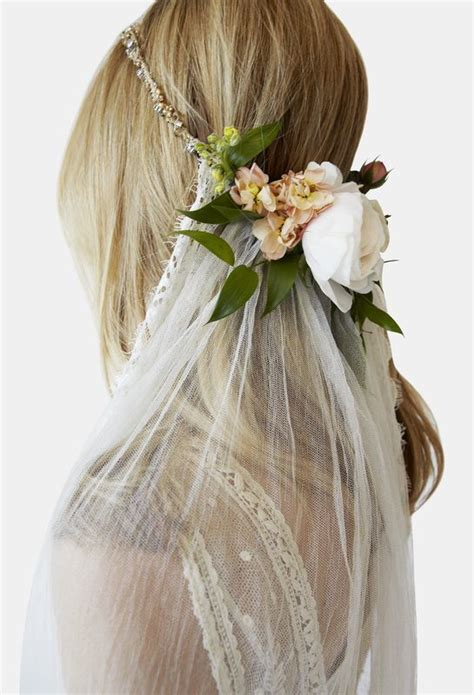 Wedding Hair With Veil And Flower by Wedding Veil With Fresh Flowers Hair
