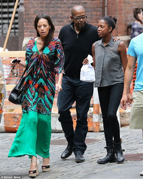 forest whitaker and his brother forest whitaker enjoys a leisurely stroll with his wife
