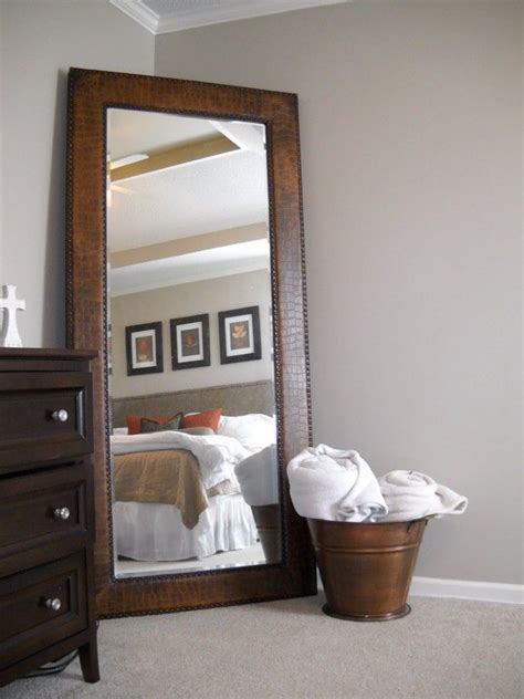 long mirrors for bedroom leaner mirror with brown wooden frame on wheat floor