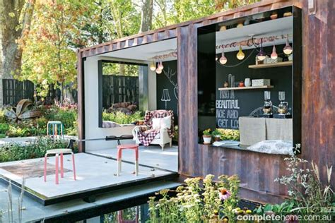 shipping container in garden designer gardens contained style completehome