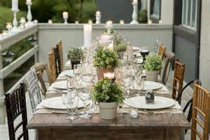 Beautiful outdoor dinner party table setting with rustic and natural