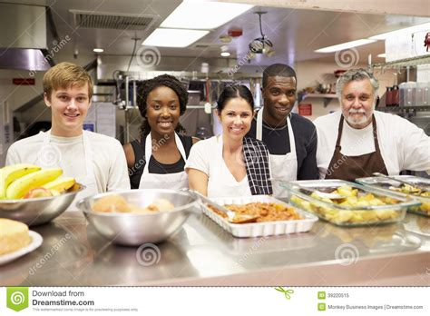 Kitchen Staffing Agencies by Portrait Of Kitchen Staff In Homeless Shelter Stock Photo