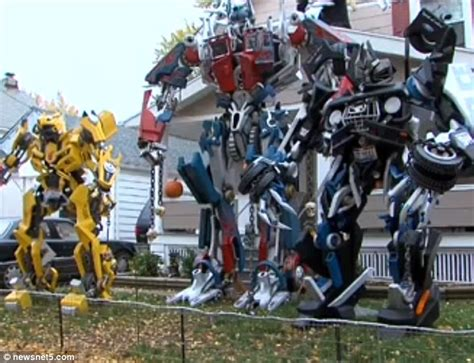 Decorated Model Homes transformers take over home s front yard halloween display