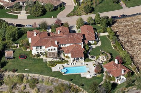 justin bieber s house khloe kardashian is moving into justin bieber s house the stir
