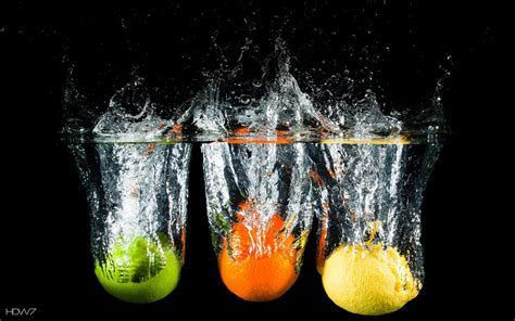 citrus fruits in water black background   HD wallpaper