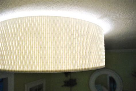 Alang Ceiling Light by A Clean Flush Mounted Light Near The Fireplace