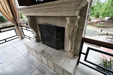 cast outdoor fireplace transitional patio