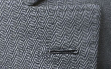 Handmade Buttonholes - signals of a handmade suit the braving of the buttonhole