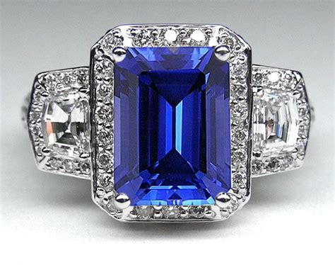emerald cut blue sapphire vintage design halo ring with