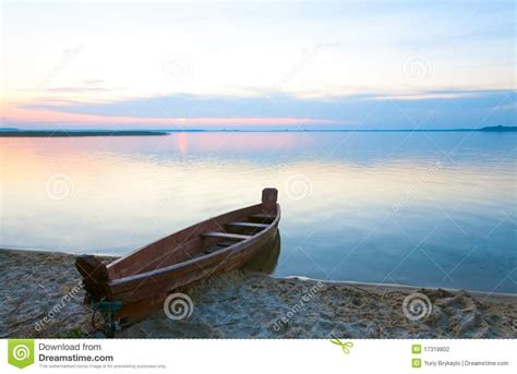 lake time boats sunset with boat near the summer lake shore stock photo