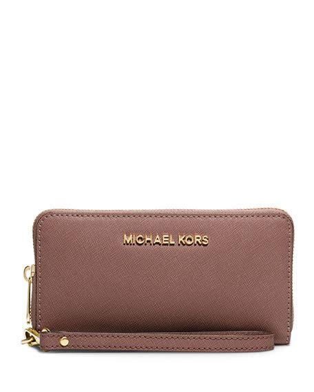 Michael Kors Travel Wallet 7 michael michael kors jet set travel saffiano multifunction tech wristlet wallet dusty
