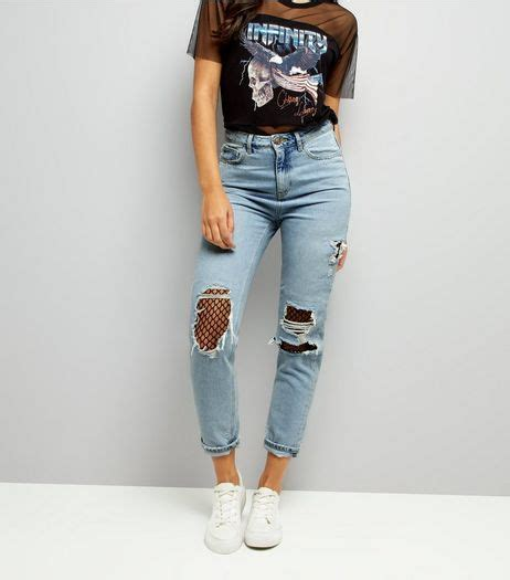 pale blue ripped fishnet knee mom jeans