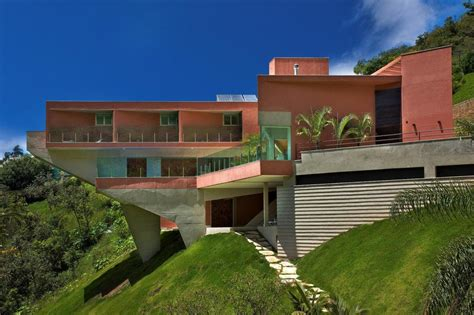 Sculptural Concrete House Built on a Steep Slope   Modern