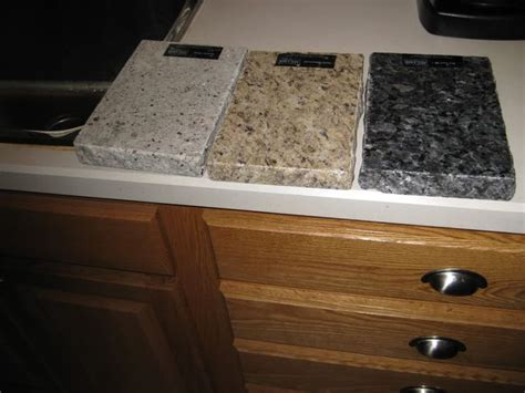 kitchen cabinets with light granite countertops golden oak kitchen cabinets with black countertops