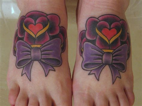 bow and rose tattoo and purple bow tattoos on both